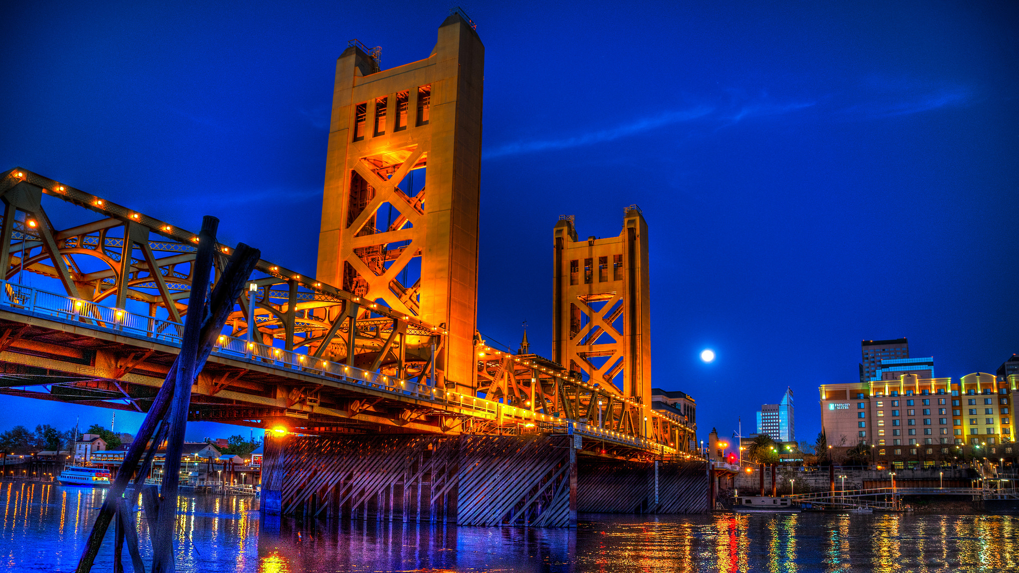 The yellow Tower Bridge is an iconic landmark of Sacramento. Beautiful colors and contrast at night, the tower bridge brings a certain light to any engagement session.